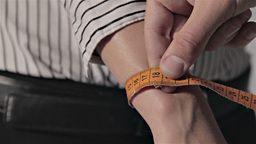 Tailor Measuring For Woman - Wrist stock footage