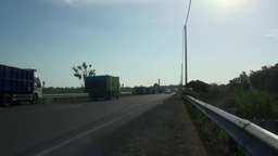 Landscape Trucks Traffic Main Road In Bali stock footage