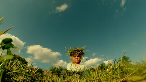 fair-haired daughter of a farmer weaves a wreath m Footage
