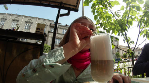 little girl is drinking cocoa through a straw from Footage