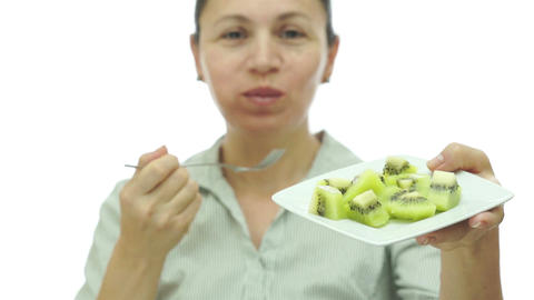 Woman Eating Kiwi Fruit Off Of Plate stock footage