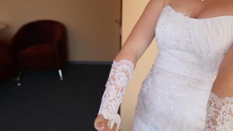 bride wears wedding gloves Footage