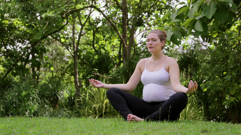 3of 10 Relaxed Pregnant Woman , Mom Doing Yoga stock footage