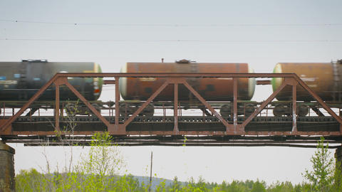 Freight train moving along the bridge over the riv Footage