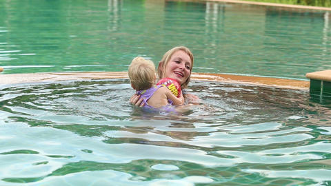 Child And Mother Swim In The Pool stock footage