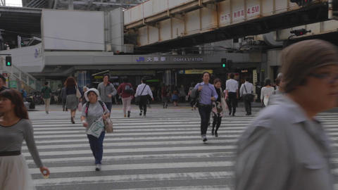 JR Osaka station - pedestrians cross street Footage