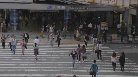 birds eye angle JR Osaka station - pedestrians run Footage