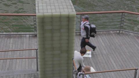 man paints at Dotonbori canal Footage