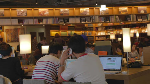Men On Cell Phone Laptop At Starbucks stock footage