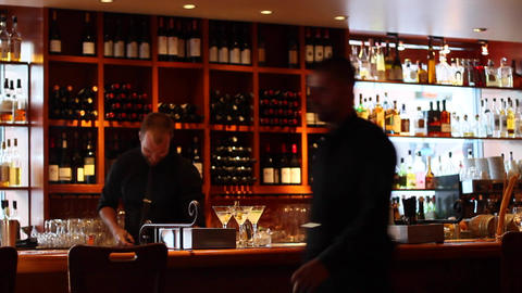 bar tender with martinis at chic sushi bar Footage