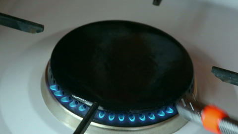 gas ignited by lighter in the burner gas stove Footage
