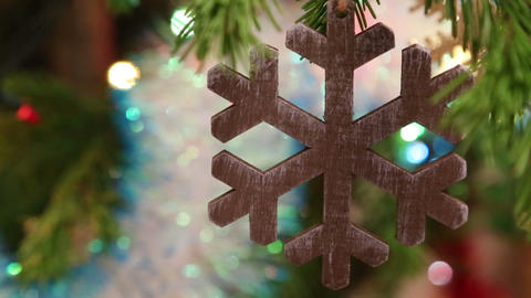 christmas wooden snowflake hanging on fir twig Footage