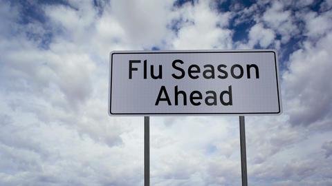Flu Season Ahead Sign Clouds Timelapse stock footage