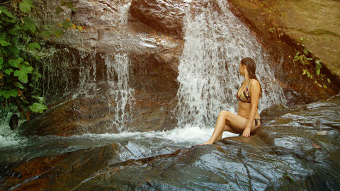 Tourist Bathing In The Forest Waterfall. Thailand stock footage