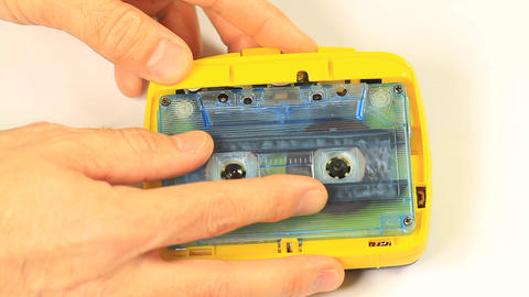 Inserting Cassette In The Tape Recorder stock footage