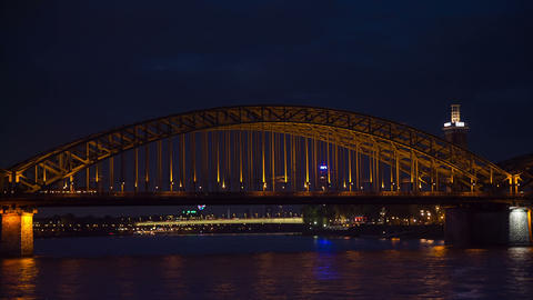 Railroad bridge in Cologne at night, timelapse Footage