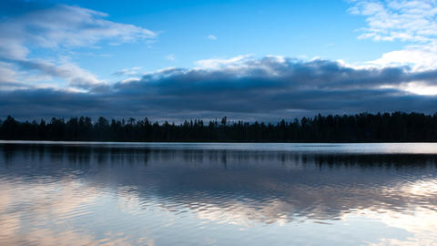 clouds over the lake, timelapse Stock Video Footage