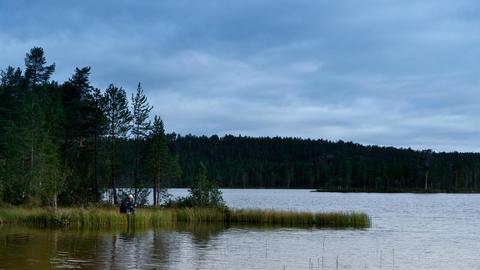 fishermen fishing on lake, timelapse Stock Video Footage