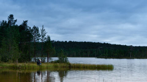fishermen fishing on lake, timelapse Stock Video Footage