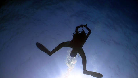 Diver swims over camera Stock Video Footage