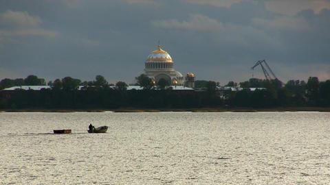 boat floats on the background of the cathedral Stock Video Footage