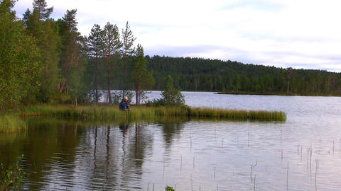 fishermen fishing on lake Stock Video Footage