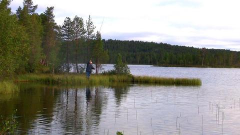 fishermen fishing on lake Stock Video Footage