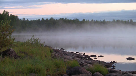 fog and ripples on a lake, loop Stock Video Footage