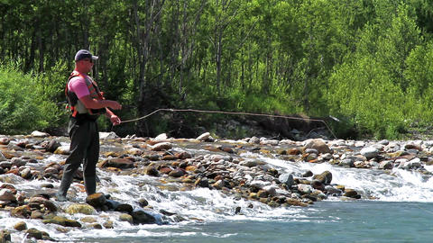 The fisherman and fly fishing Stock Video Footage