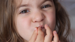 little girl tight lipped Stock Video Footage