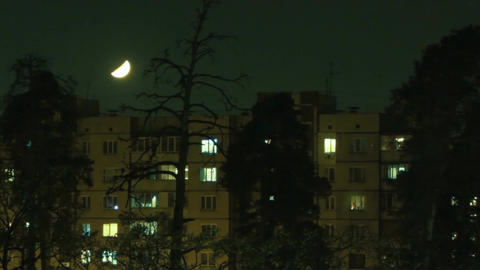 Moon Hides Behind The House stock footage