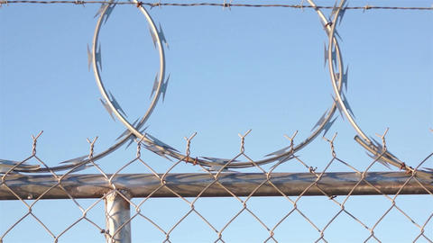 Razor Wire Fence Shaking Pan Footage