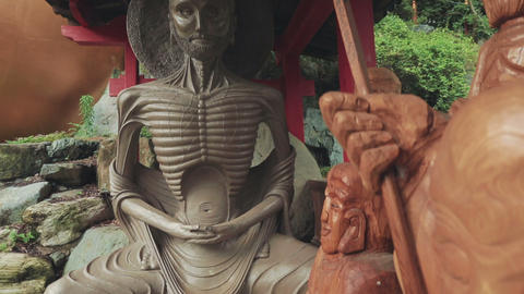 Starving Buddha Statue Outside Japanese Temple stock footage