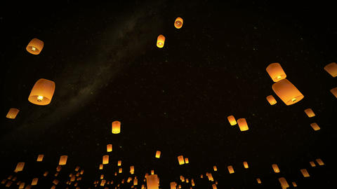 4k beautiful lead couple Lanterns flying in night Stock Video Footage