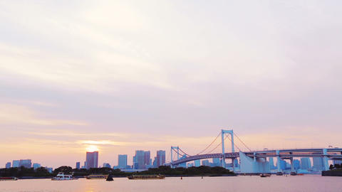 The famous Rainbow Bridge at sunset with Tokyo in  Footage