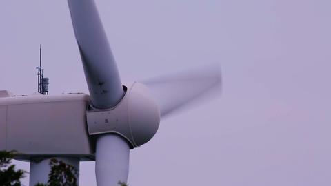 Profile shot of a spinning windmill Footage