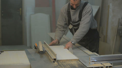 carpenter cutting the wooden panel with circular s Footage