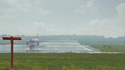 Pink plane landing amid mirage Footage