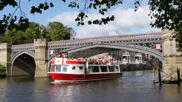 River Cruise Boat Passes Under Bridge. River Ouse, stock footage