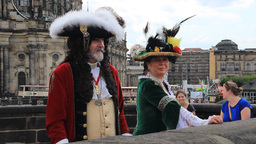 People in baroque outfit strolling in the city of  Live Action