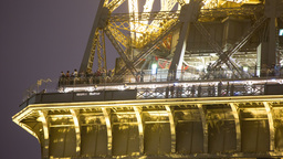 paris eiffel tower at night, closeup with tourists Footage
