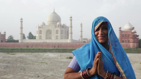Indian Woman wearing Sari in front of Taj Mahal Footage