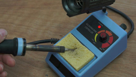 Industrial Soldering Iron Cleaning Footage