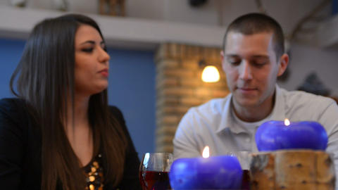 Love Couple Sitting At A Table And Drink Wine stock footage