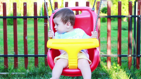 Baby boy in a swing 2 Footage