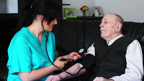 Blood pressure check to a senior Footage