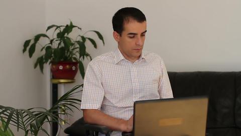 Businessman in wheelchair working on laptop Footage