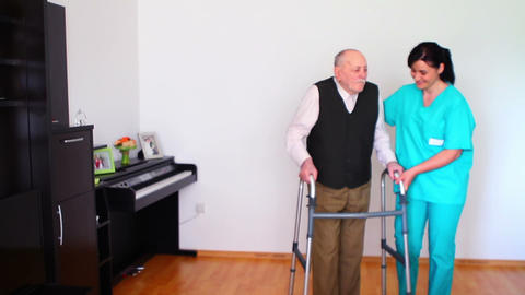 Carer Helping Elderly Senior Man Using Walking stock footage