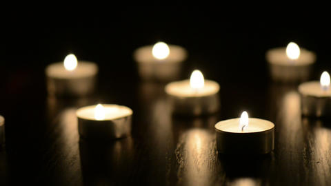 Small Flaming Candles On Black Table stock footage