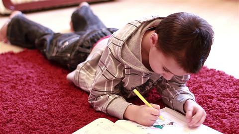 Little boy coloring Live Action